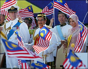Prince Andrew looks on during a parade at the historic Merdeka Square in downtown Kuala Lumpur